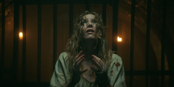 Charlotte Kirk as Grace Haverstock in the horror film, THE RECKONING, a RLJE Films/Shudder release. Photo courtesy of RLJE Films/Shudder.